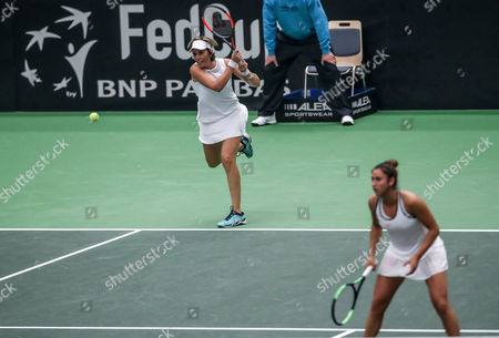 Spain's Sara Sorribes Tormo (R) and Maria Jose Martinez Sanchez in action against Lucie Safarova and Katerina Siniakova (both unseen) of Czech Republic during their double match of the Tennis Fed Cup World Group first round tie between the Czech Republic and Spain in Ostrava, Czech Republic, 12 February 2017.
