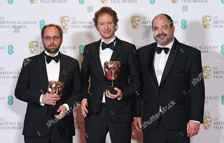 Director Laszlo Nemes (C) poses with producers Gabor Sipos (L) and Gabor Rajna (R) in the press room after winning an award for 'Film Not In The English Language' for 'Son of Saul' during the 2017 EE British Academy Film Awards at The Royal Albert Hall in London, Britain, 12 February 2017. The ceremony is hosted by the British Academy of Film and Television Arts (BAFTA).