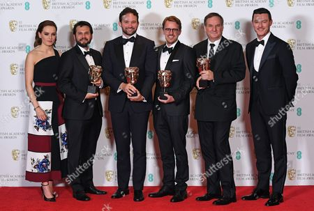 Actors Daisy Ridley (L) and Luke Evans (R) pose with special visual effects editors Robert Legato (2-R), Dan Lemmon (3-L), Andrew R. Jones (3-R) and Adam Valdez (2-L) in the press room after winning the award 'Best Special Effects' for 'Jungle Book' during the 2017 EE British Academy Film Awards at The Royal Albert Hall in London, Britain, 12 February 2017. The ceremony is hosted by the British Academy of Film and Television Arts (BAFTA).