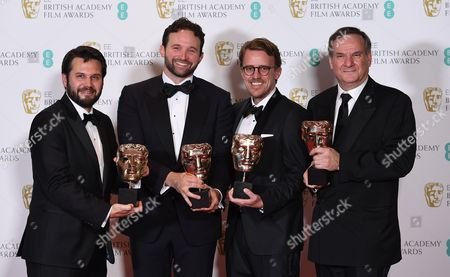 Special visual effects editors Robert Legato (R), Dan Lemmon (2-L), Andrew R. Jones (2-R) and Adam Valdez (L) pose in the press room after winning the award 'Best Special Effects' for 'Jungle Book' during the 2017 EE British Academy Film Awards at The Royal Albert Hall in London, Britain, 12 February 2017. The ceremony is hosted by the British Academy of Film and Television Arts (BAFTA).