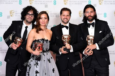Babak Anvari, Emily Leo, Oliver Roshill and Lucan Toh (L-R) pose in the press room after winning the award for Outstanding Debut for British Writer, Director and Producer for the film 'Under the Shadow' during the 2017 EE British Academy Film Awards at The Royal Albert Hall in London, Britain, 12 February 2017. The ceremony is hosted by the British Academy of Film and Television Arts (BAFTA).