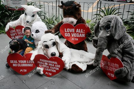 Children play with animal rights advocates from People for the Ethical Treatment of Animals (PETA) dressed as different animals and holding placards during a demonstration in Makati City, south of Manila, Philippines, 13 February 2017. Members of PETA encouraged the public to show compassion to all living things as Valentine's day approaches. Wearing different animal costumes, the animal rights advocates carried signs in various languages and went around the business district of Makati dancing and giving hugs.