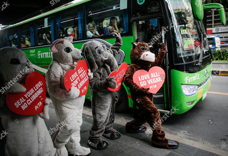 Animal rights advocates from People for the Ethical Treatment of Animals (PETA) dressed as different animals hold placards during a demonstration in Makati City, south of Manila, Philippines, 13 February 2017. Members of PETA encouraged the public to show compassion to all living things as Valentine's day approaches. Wearing different animal costumes, the animal rights advocates carried signs in various languages and went around the business district of Makati dancing and giving hugs.