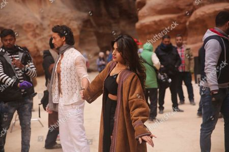 """Sana Saeed, Tiger Shroff Bollywood rising female lead Sana Saeed holds hands with film star Tiger Shroff during the filming their new movie, """"Munna Michael,"""" in Jordan's iconic Petra archaeological site. Shroff, Saeed and an Indian cinema crew are filming across Jordan for the film directed by Sabir Khan"""