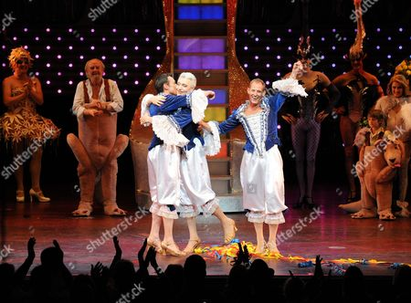 Stock Picture of Todd Mckenney Waves Goodbye to the Fans of the Show as Tony Sheldon and Daniel Scott Hug.