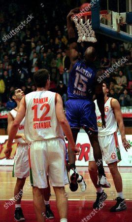 Istanbul Turkey: Robert Martin (#15) From Spanish Team Real Madrid Scores a Basket As Turkish Team Ulker Istanbuls Players Kevin Rankin (#12) and Dejan Koturovic (#6) Watch Him During Their Euroleague Basketball Match in Istanbul 07 January 1999 Epa-photo/epa/kerim Oekten/k/cl/ow Turkey Istanbul