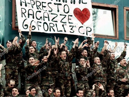 Sarajevo Bosnia and Hercegovina: Italian Nato-led Sfor Soldiers Turn Into Enthusiastic Soccer Fans to Support Italian Pop Star Eros Ramazotti who was Playing in a Charity Soccer Match in Sarajevo Grbavica Stadium 19 October 1998 the Match Against a Bosnian Team was Organised to Raise Funds For Demining Operations Around Schools in Bosnia Epa-photo/epa/fehim Demir/lmt/kr/ow Bosnia and Hercegovina Sarajevo