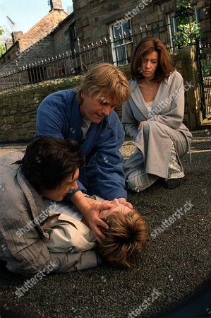 'Peak Practice'   TV Pictured: Will Preston (Simon Shepherd) Tries to Save Tony's (Adam Croasdell) Girlfriend Abbey (Lucy Robinson) Who Has an Ectopic Pregnancy.  Kate Preston (Shelagh Mcleod) Looks on.