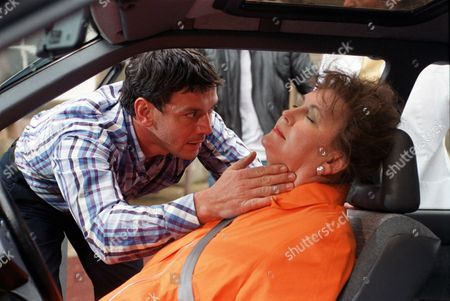 Stock Image of 'Peak Practice'   TV Pictured: Dr Tom Deneley Gives First Aid to Shelia Spencer (Sarah Badel)