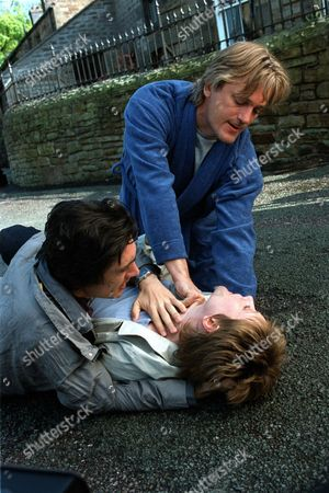 'Peak Practice'   TV Pictured: Will Preston (Simon Shepherd) Tries to Save Tony's (Adam Croasdell) Girlfriend Abbey (Lucy Robinson) Who Has an Ectopic Pregnancy.
