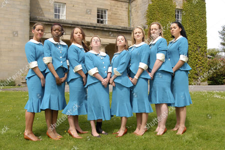 'Ladette To Lady' TV programme -  L-R:  Ladettes Charlotte Donohue, Neema Mattaker, Laura Waude, Simone Webber, Holly Clements, Nicole Hart, Amber Jacques and Kelly Simpson, all wearing the Eggleston Hall Summer uniform