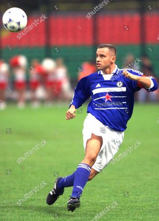 Warsaw Poland: Italian Musician Eros Ramazotti Shows His Skills As a Soccer Player During a Charity Match Between Italian and Polish Artists Saturday 25 September 1999 in Warsaw All Money Raised During the Match is For the Benefit of the Planned Project Tolerance School a School and Meeting Point For Children From All Ethnic Groups in the Kosovo Province Epa-photo/epa/janek Skarzynski/stf/gh/ow Electronic Image Poland Warsaw