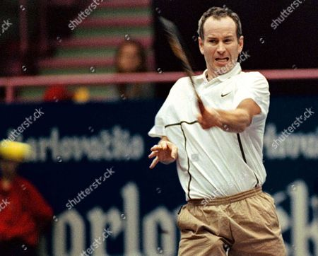 Zagreb Croatia: Us Tennis Veteran John Mcenroe Retyurns a Ball to Bjorn Borg of Sweden During on the Second Day of Atp Senior Tour of Champions Match in Zagreb 14 November 1998 Tennis Veterans Like John Mcenroe Bjorn Borg Henri Laconte Mats Wilander and Others Are Taking Part in the Charity Tournamet For Unicef Epa-photo/epa/antonio Bat/stf/ab/fob/ow Croatia Zagreb
