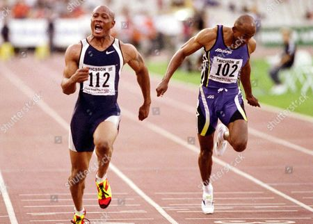 Athens Greece: Us Sprinter Maurice Green (l) Screams out As He Crosses the Finish Line to Set a New World Record in the Mens 100-meter Dash Clocking 9 79 Seconds in the Tsiklitiria 99 Athletics Grand Prix Meeting at Athens Olympic Stadium on Wednesday 16 June 1999 Green is the First Man to Cover the Distance in Under 9 80 Seconds the Previous World Record Holder was Canadas Donovan Bailey with 9 84 in the 1996 Olympic Games in Atlanta on Right is Namibian Frankie Fredericks Epa-photo/epa/in Time/str/sp-fob/kr/bb Greece Athens