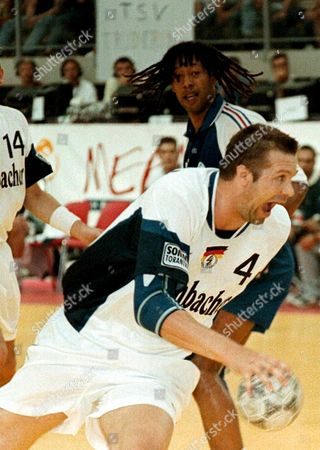 Merano Italy: Bogdan Wenta of Germany (r) Leads the Ball Infront Olivier Girault of France During Their European Handball Championship Match in Merano 03 June 1998 Evening