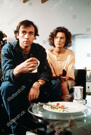 Stock Photo of 'The One Game'  TV - 1987 -  Nick (Stephen Dillon) and Fay (Kate Mckenzie), Who Are Lovers, Sit Down to a Cup of Tea.