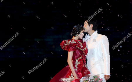 South Korean Actor Park Si-hoo (r) and Actress Han Chae-young Display South Korean Designer Andre Kim's Work on the Eve of the 2008 Bali Fashion Week in Bali Indonesia 25 August 2008 Indonesia Bali