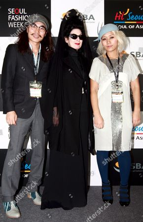 World-renowned Fashion Journalist Diane Pernet (c) and Designers Steve Jung (l) and Yoni Pai Pose For Photographers at the Seoul Fashion Week S/s 2009 at a Seoul Convention Center on 20 October 2008 in Seoul South Korea Korea, Republic of Seoul