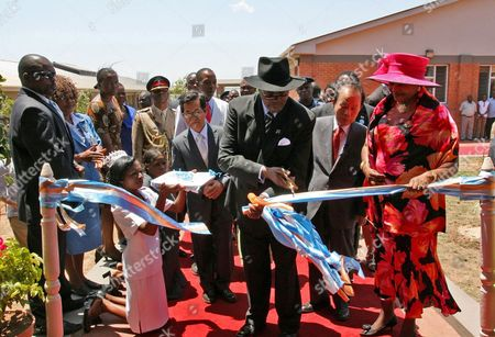 Malawi President Bingu Wa Mutharika (3-r) Cuts the Tape to Mark the Opening of Daeyang Nursing College in Lilongwe Malawi 18 October 2010 the Facility was Set Up by Chung Yoo-keun (2-r) Chairman of South Korea's Daeyang Shipping Company Korea, Republic of Lilongwe