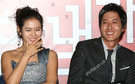 A Picture Made Available 15 October 2006 Shows South Korean Actress Sohn Ye-jin (l) and Actor Kim Joo-hyuk who Star in Director Jung Yoon-soo's Movie 'My Wife Got Married ' Smile During a Publicity Event at Cgv Theater in Seoul South Korea 14 October 2008 the Movie Will Be Released in South Korea on 23 October Korea, Republic of Seoul