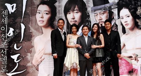 Stock Picture of The Cast of the Movie 'Miindo ' South Korean Actors (l-r) Kim Nam-gil Kim Min-sun Choo Ja-hyun and Kim Young-ho Pose For Photographers with Director Chun Yoon-soo (c) During a Publicity Event at Ewha 100th Memorial Hall in Seoul South Korea 13 October 2008 the Movie is Released in South Korea on 13 October Korea, Republic of Seoul