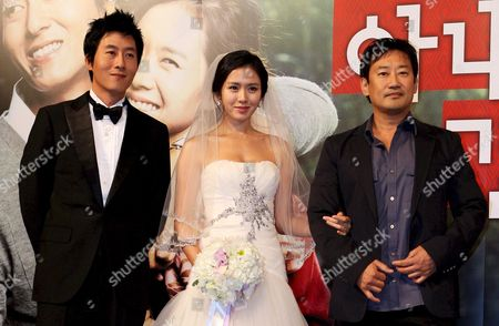 Director Jung Yoon-soo (r) Poses with the Stars of His Movie 'My Wife Got Married ' South Korean Actors Kim Joo-hyuk (l) and Sohn Ye-jin (c) During a Publicity Event at Seoul Plaza Hotel South Korea 23 September 2008 the Movie Will Be Released in South Korea on 23 October 2008 Korea, Republic of Seoul