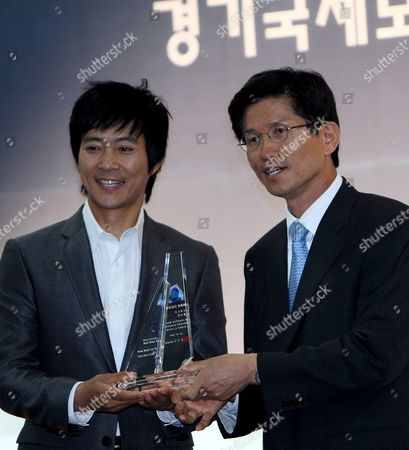 Stock Picture of Popular Actor Choi Soo-jong (l) is Appointed Promotional Ambassador For the Korea International Boat Show by Gyeonggi Gov Kim Moon-soo (r) at a Ceremony in the Port Located in the City of Hwaseong on South Korea's West Coast 10 June 2008 the Gyeonggi Provincial Government Will Open the Boat Show on 11 June in the Port of Jeongok Korea, Republic of Hwaseong