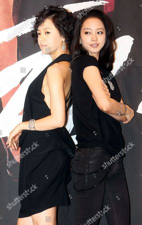 The Stars of New Drama 'Tazza ' Or 'The War of Flowers' -- South Korean Actresses Kang Sung-yeon and Han Ye-seul (r) -- Pose For a Photo During a Publicity Event at Broadcaster Sbs's Main Complex in Seoul South Korea 08 September 2008 the Drama Will Be Aired by Sbs Starting 16 September Korea, Republic of Seoul