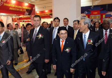 Visiting Latvia Prime Minister Valdis Dombrovskis (l) Being Escorted by Lee Ju-tae (c) Chairman of the Korea Importers Association and South Korea's Trade Minister Kim Jong-hoon (r) As They Look Around an Imported Goods Exhibition in Seoul South Korea on 09 June 2011 Reports State That From June 08 to 11 June 2011 Dombrovskis and 16 Latvian Businessmen Representing Logistics Finance Wood Processing and Tourism Sectors Are Visiting South Korea to Meet with Korean Businessmen and High-ranking Officials to Improve Economic Cooperation Between Latvia and South Korea Korea, Republic of Seoul