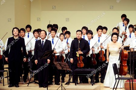 Maestro Chung Myung-hoon (2-l Front Row) Along with Conductor Jung Min (l) Violinist Dennis Kim (2-r) and Cellist Chung Myung-hwa After Holding a Concert with a Children's Orchestra in Busan South Korea 25 August 2008 Korea, Republic of Busan