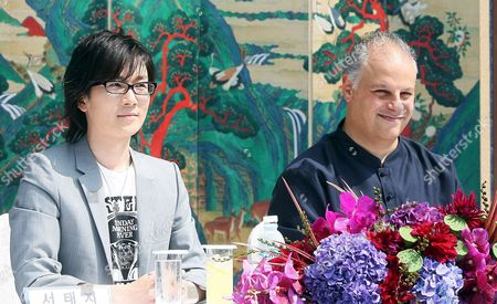 South Korean Pop Star Seo Taiji (l) Holds a Press Conference to Promote 'The Great 2008 Seo Taiji Symphony' at Doeksoo Palace in Seoul 29 August 2008 Tolga Kashif (r) Will Direct the Royal Philharmonic Orchestra For the Concert to Be Held at World Cup Stadium in Seoul on 27 September Korea, Democratic People's Republic of Seoul