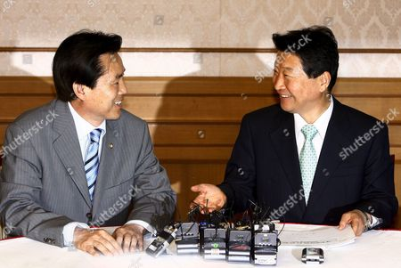 Stock Image of South Korean Ahn Sang-soo (r) Floor Leader of the Ruling Grand National Party (gnp) Holds Talks with His Counterpart Kim Hyo-suk of the Main Opposition United Democratic Party at the National Assembly in Seoul South Korea on 15 April 2008 the Two Floor Leaders Met For the First Time Since the Gnp Secured a Slim Majority in the Unicameral Parliament in General Elections Earlier This Month Korea, Republic of Seoul