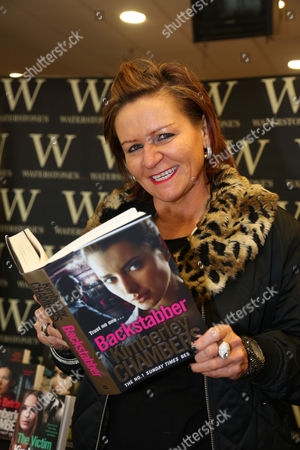 Crime author, Kimberley Chambers signs copies of her latest book, 'Backstabber' at Waterstones bookshop, The Liberty in Romford, Essex.