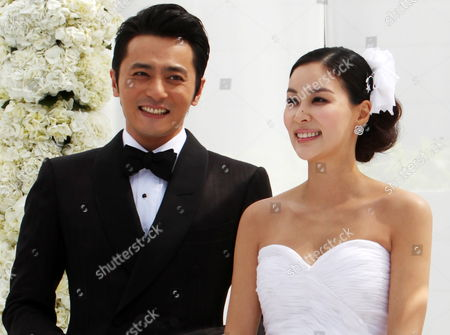Stock Picture of South Korean Actors Jang Dong-gun (l) and Ko So-young (r) Smile While Posing For Photographs Ahead of Their Wedding at a Hotel in Seoul South Korea 02 May 2010 Korea, Republic of Seoul