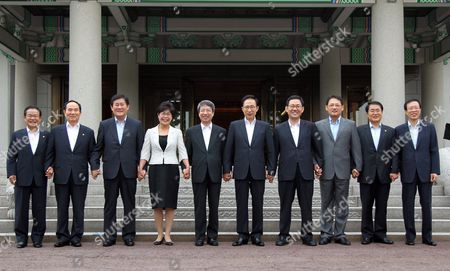 President Lee Myung-bak (5th From R) Poses with Outgoing Ministers Including Prime Minister Chung Un-chan (5th From L) After Holding a Cabinet Meeting at the Presidential Office Cheong Wa Dae in Seoul South Korea 10 August 2010 From Left Are Kwon Tae-shin Chief of the Office of Prime Minister Education Minister Ahn Byong-man Knowledge Economy Minister Choi Kyung-hwan Health Minister Jeon Jae-hee Chung Lee Minister For Special Affairs Joo Ho-young Culture Minister Yoo In-chon Agriculture Minister Jang Tae-pyong and Government Legislation Minister Lee Seog-yeon Korea, Republic of Seoul
