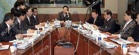 South Korea's President Lee Myung-bak (c) Receives a Report on North Korea's Rocket Launch Over the Telephone From Kim Tae-young Chairman of the Joint Chiefs of Staff During a National Security Council Meeting at the Presidential Office Cheong Wa Dae in Seoul South Korea 05 April 2009 North Korea Carried out a Provocative Rocket Launch That the Us Japan and Other Nations Suspect was a Cover For a Test of Its Long-range Missile Technology Korea, Republic of Seoul