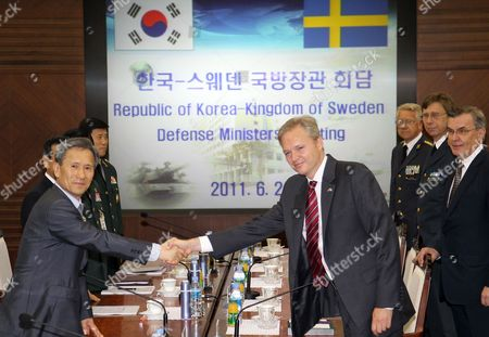 Stock Photo of South Korean Defense Minister Kim Kwan-jin (l) and His Visiting Swedish Counterpart Sten Tolgfors Pose Prior to Their Talks at the Defense Ministry in Seoul South Korea on 21 June 2011 Korea, Republic of Seoul
