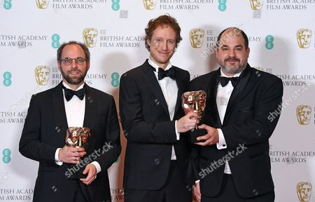 Stock Image of Director Laszlo Nemes (C) poses with producers Gabor Sipos (L) and Gabor Rajna (R) in the press room after winning an award for 'Film Not In The English Language' for 'Son of Saul' during the 2017 EE British Academy Film Awards at The Royal Albert Hall in London, Britain, 12 February 2017. The ceremony is hosted by the British Academy of Film and Television Arts (BAFTA).