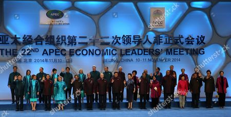 A Picture Made Available on 11 November 2014 Shows Leaders and Their Spouses of Member Countries of Asia-pacific Economic Cooperation (apec) Posing For a Family Photo at the Water Cube Or National Aquatic Center Before a Welcome Banquet in Beijing China 10 November 2014 the Asia-pacific Economic Cooperation (apec) 2014 Summit and Related Meetings Will Be Held in Beijing From 05 to 11 November Gathering Leaders of 21 Member Economies (front L-r) Taiwanese Representative Vincent Siew Mexican President's Wife Angelica Rivera and President Enrique Pena Nieto Chilean President Michelle Bachelet Sultan of Brunei Hassanal Bolkiah Philippine President Benigno Aquino Iii Russian President Vladimir Putin Chinese President Xi Jinping and His Wife Peng Liyuan Indonesian President Joko Widodo and Wife Iriana Us President Barack Obama South Korean President Park Geun-hye Peruvian President Ollanta Humala Thai Prime Minister Prayut Chan-o-cha and Wife Naraporn (back L-r) Hong Kong 'S Chief Executive Leung Chun-ying New Zealand Prime Minister's Wife Bronagh Key and Prime Minister John Key Japanese Prime Minister's Wife Akie and Prime Minister Shinzo Abe Canadian Prime Minister's Wife Laureen and Prime Minister Stephen Harper Australian Prime Minister Tony Abbott Malaysian Prime Minister Najib Razak and Wife Rosmah-mansor Papua New Guinea Prime Minister Peter O?neill and Wife Lynda May Babao Singapore Prime Minister Lee Hsien Loong and Wife Ho Ching Vietnam's President Truong Tan Sang and Wife Mai Thi Hanh China Beijing