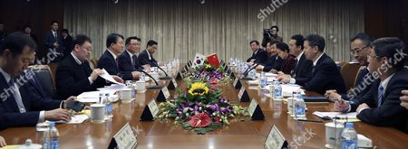 Kang Sin-myeong (3-l) South Korea's National Police Agency Chief and Meng Hongwei China's Deputy Minister of Public Security (4-r) Hold Talks on Strengthening Bilateral Cooperation on Stopping Cybercrimes in Beijing China 23 February 2016 the Two Officials Also Discussed Forming a Three-nation Public Safety Consultative Body with Japan China Beijing