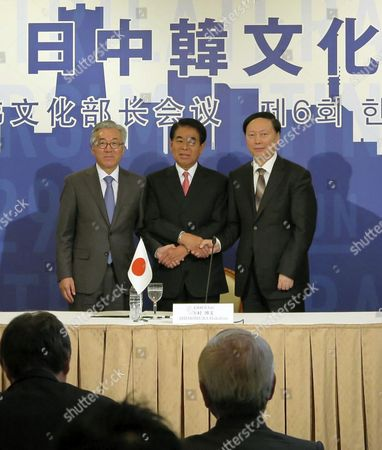 Ministers of Culture Sports and Tourism South Korean Kim Jong-deok (l) and Japanese Hakubun Shimomura (c) Pose For a Picture with Their Chinese Counterpart After Holding a Meeting in Yokohama Japan 30 November 2014 the Three Countries Adopted a Joint Statement Calling For More Cultural Exchanges Among Them Japan Yokohama