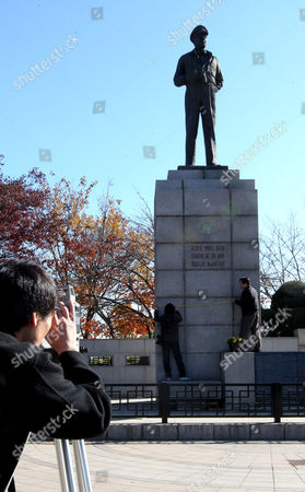 A Safety Check is Made on the Statue of Gen Douglas Macarthur at Freedom Park in Incheon South Korea on 22 November 2010 53 Years After It was Built the South Korean Government Built the Statue in Incheon in Honor of the American General who Turned the Tide of the 1950-53 Korean War in Favor of South Korea by Leading an Incheon Landing Operation in 1950 Korea, Republic of Incheon