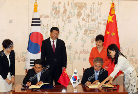 Stock Photo of A Picture Made Available on 04 July 2014 Shows South Korean Culture Minister Yoo Jin-ryong (r Front) Signs an Agreement with Cai Fuchao Director of China's State Administration of Radio Film and Television at the Presidential Office Cheong Wa Dae in Seoul South Korea 03 July 2014 Under the Pact Jointly Produced Movies Will Be Classified As Both South Korean and Chinese Films South Korean President Park Geun-hye (r Rear) and Chinese President Xi Jinping (l Rear) Attended the Signing Ceremony Korea, Republic of Seoul