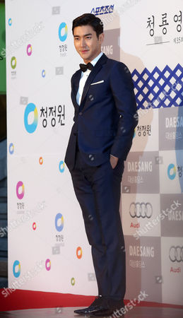 A Picture Made Avaialable on 18 December 2014 Shows South Korean Actor Choi Si-won Arriving For the 35th Blue Dragon Film Awards at the Sejong Center For Peforming Arts in Seoul South Korea 17 December 2014 Korea, Republic of Seoul