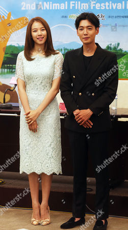 Stock Image of South Korean Actor Jung Kyung-ho (r) and South Korean Actress Jo Yoon-hee (l) Pose During a Photocall For the 2nd International Animal Film Festival in Seoul South Korea 29 July 2014 Korea, Republic of Seoul