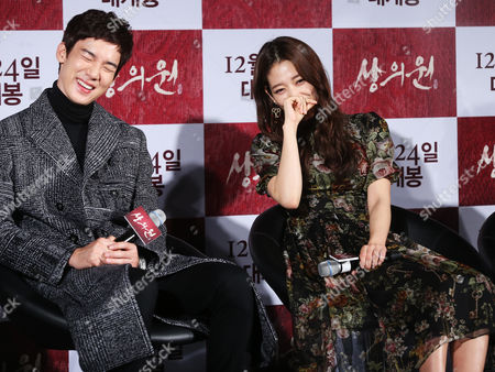South Korean Actor Yoo Yeon-seok and Park Shin-hye (r) Laugh During a Press Conference to Promote the New Film 'The Royal Tailor' the Story of Tailors Making Clothes For the Royal Family During the Joseon Dynasty (1392-1910) in Seoul South Korea 26 November 2014 Korea, Republic of Seoul