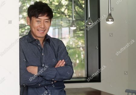 South Korean Actor Sol Kyung-gu Starring in the New Movie 'My Dictator' Poses Ahead of an Interview at a Cafe in Samcheong-dong Seoul South Korea 22 October 2014 Korea, Republic of Seoul
