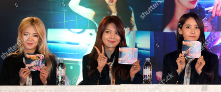 Stock Image of South Korean Girls' Generation Music Group Members Kim Hyo-yeon (l) Sooyoung (c) and Im Yoona Attend an Autograph Event in Seoul South Korea 16 March 2014 Korea, Republic of Seoul