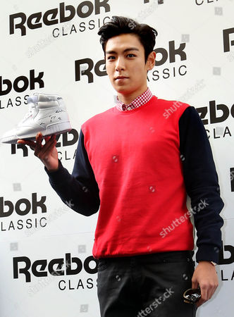 T O P a Member of K-pop Group Big Bang Poses During a Footwear Promotion Event in Myeongdong Downtown Seoul South Korea 19 August 2014 Korea, Republic of Seoul