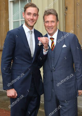 Cricketer Stuart Broad with his father Chris Broad receives the MBE